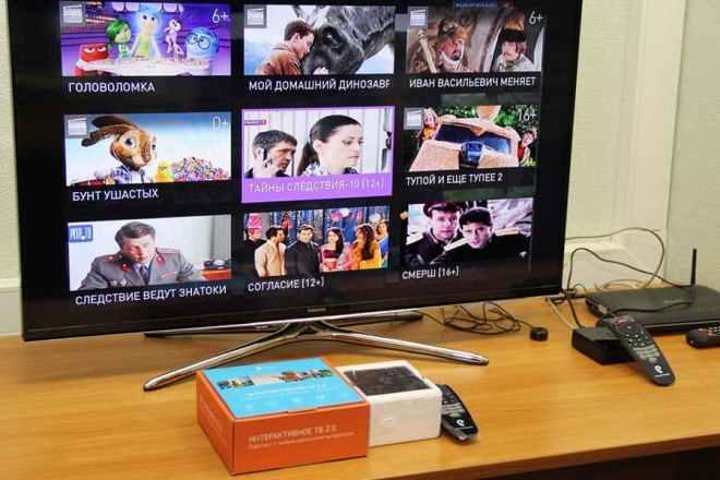 ТВ-приставка Ростелеком с пультом ДУ и телевизором