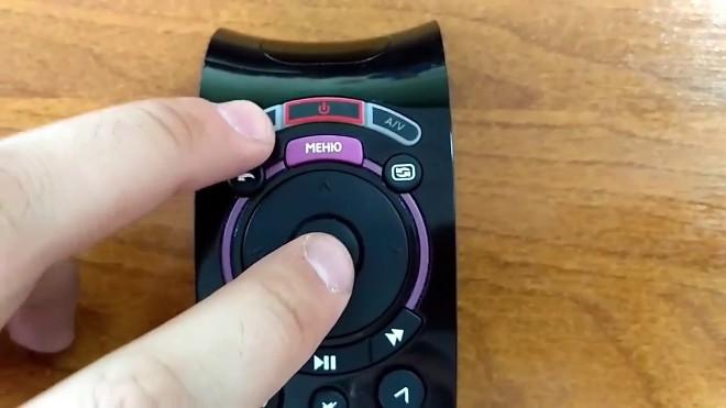 Зажатие кнопок OK и Power на пульте Ростелеком